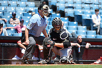 Home plate umpire Brandon Misun and Omaha Storm Chasers catcher Jesus Flores (25) during a game against the Nashville Sounds on May 20, 2014 at Herschel Greer Stadium in Nashville, Tennessee.  Omaha defeated Nashville 4-1.  (Mike Janes/Four Seam Images)