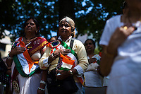 Women sing the national hymn while they attend the annual Indian independence day parade in New Jersey,  August 11, 2013. Photo by Eduardo Munoz Alvarez / VIEWpress.