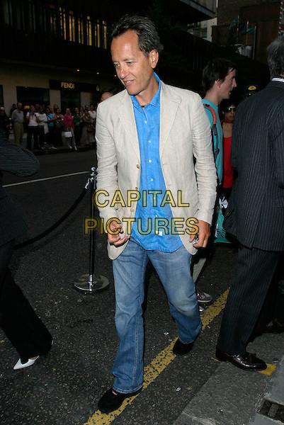 RICHARD E. GRANT .Launch party for the 21st anniversary issue of Elle Magazine at the Versace Store in Sloane Street, London, UK..September 7th, 2006.Ref: AH.full length jeans denim beige jacket blue.www.capitalpictures.com.sales@capitalpictures.com.©Adam Houghton/Capital Pictures.