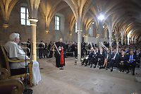 Pope Benedict XVI listens to speeches by cultural leaders at the College des Bernardins in Paris, Friday Sept. 12, 2008.