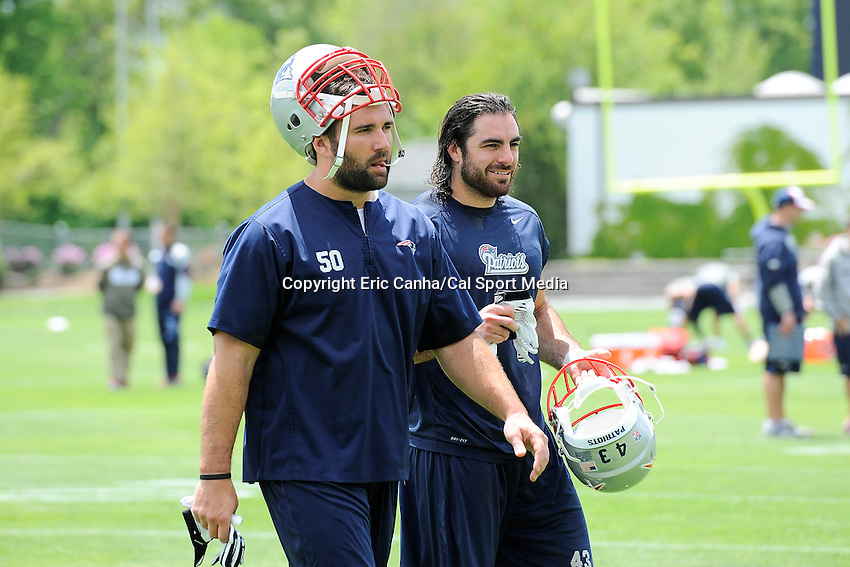 May 30, 2014 - Foxborough, Massachusetts, U.S. - New England Patriots linebacker Rob Ninkovich (50) (left) and defensive back Nate Ebner (43) (right) walk off the practice field at the end of the team's OTA at Gillette Stadium in Foxborough, Massachusetts. Eric Canha/CSM
