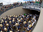 Sept. 21, 2013; The football team takes the field against Michigan State.<br /> <br /> Photo by Matt Cashore