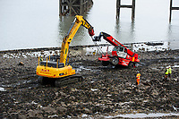 Pictured: A crane getting pulled out of the sea at Mumbles Pier. Thursday 24 January 2019<br /> Re: A recovery operation is on its way to retrieve a crane which got stuck in mud and trapped by the incoming tide by Mumbles Pier near Swansea, Wales, UK.<br /> The crane was part of work on the refurbishment of Mumbles Pier.<br /> The historic landmark is undergoing a £3.2m restoration which began in last year.<br /> But work has been delayed partly due to two large storms which hit south Wales and now the crane became stuck in mud on Tuesday afternoon.