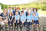 The junior infants class at Glenbeigh National School on Monday were Tighan McDonogh, Tadhg O'Sullivan, Robert Baggett, Martin Zadojenko, Katie MOrgan, Mary Kate Smith, Maoliosa Scales, Emily O'Sullivan, Aoibhin O'Donovan, Síofra Griffin, Naoise Burke and Roisin King with their teacher Karen Joy. ......................................................