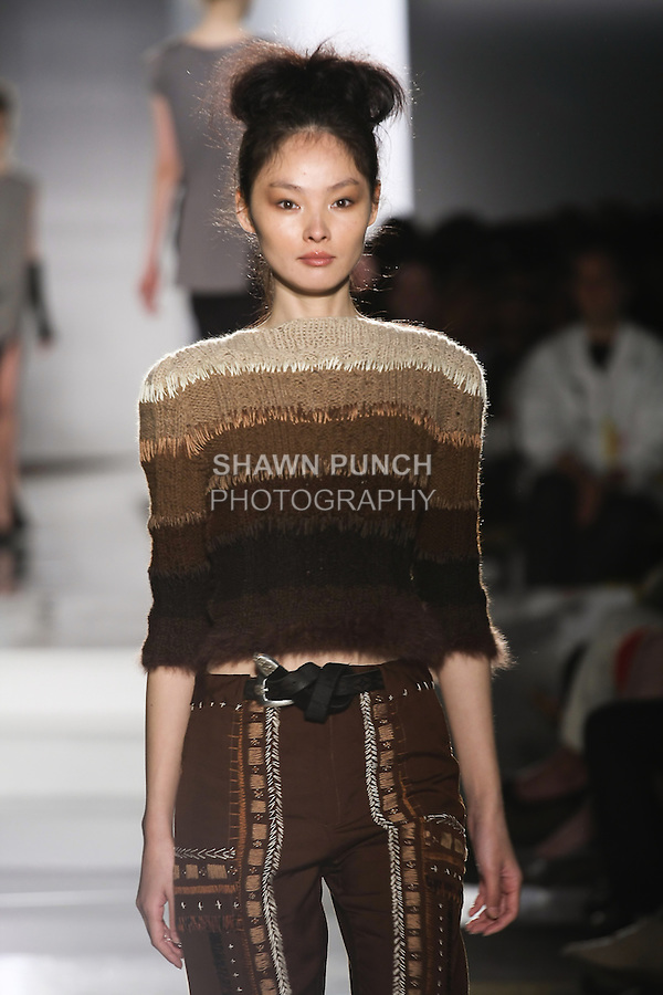 Model walks runway in an outfit by Gousche Kim, for the Parsons 2011 BFA Fashion Show, hosted by Reed Krakoff.