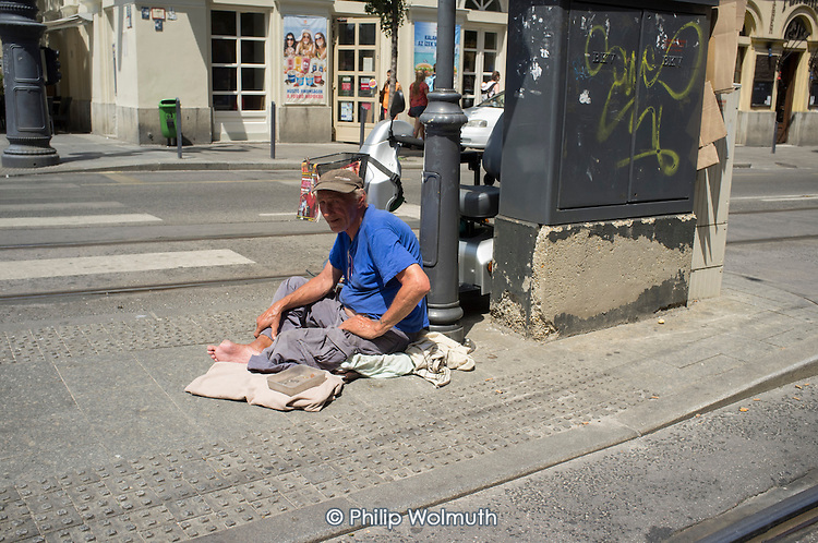 Homeless man begging at a road crossing in central Budapest