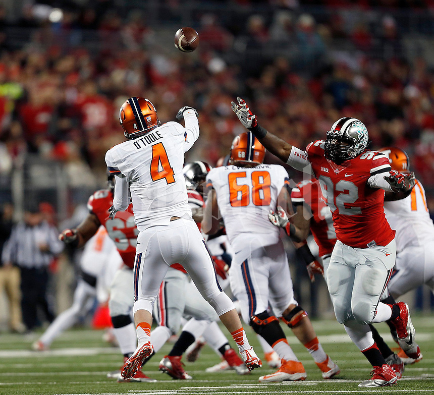 Ohio State Buckeyes defensive lineman Adolphus Washington (92) puts pressure on Illinois Fighting Illini quarterback Reilly O'Toole (4) in the first quarter of the NCAA football game at Ohio Stadium on Saturday, November 1, 2014. (Columbus Dispatch photo by Jonathan Quilter)
