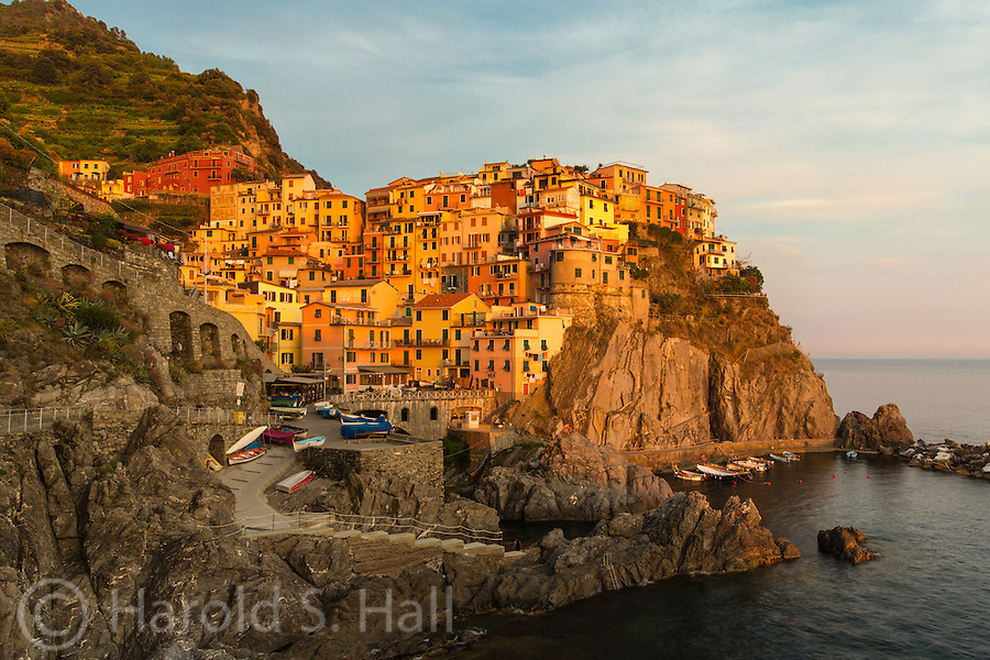 The sun sets on the tiny fishing village of Manarola, Italy.  It is one of the five towns called Cinque Tera.  No cars allwed, just boats and tourists.....