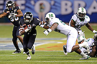 20 December 2011:  FIU running back Kedrick Rhodes (9) attempts to evade Marshall defensive lineman Jeremiah Taylor (58) in the first quarter as the Marshall University Thundering Herd defeated the FIU Golden Panthers, 20-10, to win the Beef 'O'Brady's St. Petersburg Bowl at Tropicana Field in St. Petersburg, Florida.