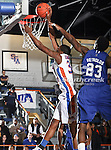 Texas-Arlington Mavericks forward Brandon Edwards (35) goes in for a slam dunk past Texas A&M-CC Islanders forward Justin Reynolds (23) in the game between the Texas A&M- Corpus Christi Islanders and the University of Texas-Arlington Mavericks held at the University of Texas in Arlington's Texas Hall in Arlington, Texas. UTA defeats Texas A&M- Corpus Christi 70 to 49..