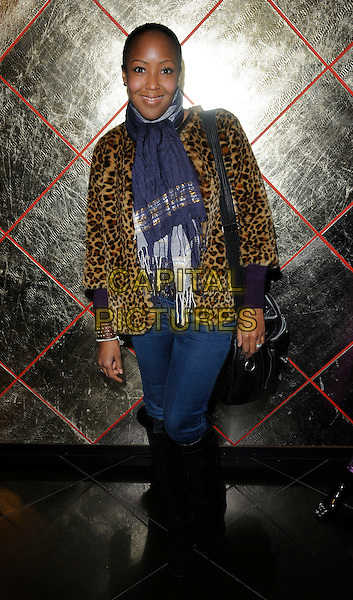 ANJELLICA BELL .At the Arrogant Cat special Christmas range launch party, Arrogant cat boutique, Great Portland Street, London, England, UK, November 26th 2010..full length leopard print fur coat jacket jeans black knee high boots grey gray scarf gold purple .CAP/CAN.©Can Nguyen/Capital Pictures.
