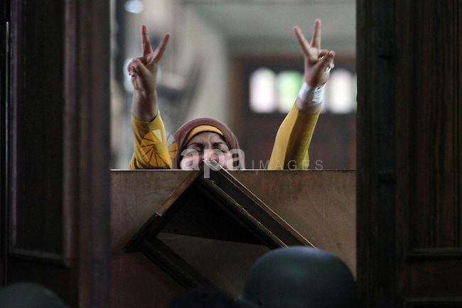 An Egyptian woman talks to policemen from the inside of Cairo's Al-Fath mosque where Islamist supporters of ousted president Mohamed Morsi hole up on August 17, 2013. The standoff at al-Fath mosque in central Ramses Square began on August 16, with security forces surrounding the building where Islamists were sheltering and trying to convince them to leave. Photo by Ahmed Asad