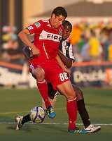 Chicago Fire midfielder Gabriel Ferrari (88) attempts to control the ball while Rochester Rhino pressures. In a Third Round U.S. Open Cup match, the Chicago Fire defeated the Rochester Rhinos, 1-0, at Sahlens Stadium on June 28, 2011.