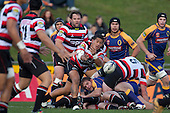 August Pulu gets the pass away from a ruck as Jono Owen watches. ITM Cup Round 1 game between the Counties Manukau Steelers and Otago, played at Bayer Growers Stadium, Pukekohe, on Saturday July 31st 2010. Counties Manukau Steelers won 29 - 13 after leading 22 - 6 at halftime.