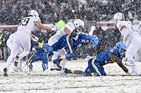 PHILADELPHIA, PA - DEC 9, 2017: Navy Midshipmen running back Keoni-Kordell Makekau (36) is tackled by a Army Black Knights defender during game between Army and Navy at Lincoln Financial Field Philadelphia, PA. Army defeated Navy 14-13 to win the Commander in Chief Cup. (Photo by Phil Peters/Media Images International)
