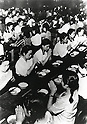 August, 1945, Aichi, Japan - Group Dinner of Japanese citizens during the Pacific campaigns of World War II from 1937 to 1945. (Photo by Kingendai Photo Library/AFLO)