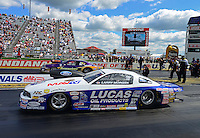 Sept 9, 2012; Clermont, IN, USA: NHRA pro stock driver Larry Morgan (near lane) races alongside Vincent Nobile during the US Nationals at Lucas Oil Raceway. Mandatory Credit: Mark J. Rebilas-