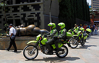 MEDELLIN, COLOMBIA - SEPTEMBER 28: Police officers stand guard after removing green cloth banners on sculptures of the Colombian artist Fernando Botero during a protest  in Medellin, Colombia on September 28, 2019. Several groups place green cloth banners on the faces of sculptures by artist Fernando Botero, protesting in the framework of the day of global action for access to legal and safe abortion, a symbolic action for women's rights. (Photo by VIEWPRESS/ Fredy Builes Corbis via Getty Images)