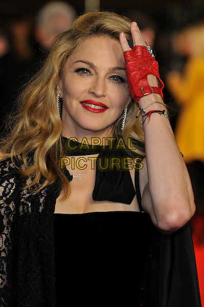 Madonna.W.E. Uk film premiere at Odeon cinema, Kensington, London, England..11th January 2011.headshot portrait black lace bow red lipstick half length hand arm glove fingerless leather bracelet .CAP/PL.©Phil Loftus/Capital Pictures.