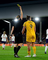 Caitlin Foord of Australia is given a yellow card during the Women's International friendly match between England Women and Australia at Ashton Gate, Bristol, England on 9 October 2018. Photo by Bradley Collyer / PRiME Media Images.