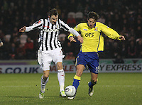 Paul Dummett (left) and Borja Perez challenge in the St Mirren v Kilmarnock Clydesdale Bank Scottish Premier League match played at St Mirren Park, Paisley on 2.1.13.