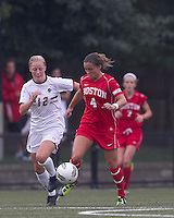 Boston University midfielder Brittany Heist (4) brings the ball forward as Boston College midfielder Julia Bouchelle (12) closes. After 2 complete overtime periods, Boston College tied Boston University, 1-1, after 2 overtime periods at Newton Soccer Field, August 19, 2011.