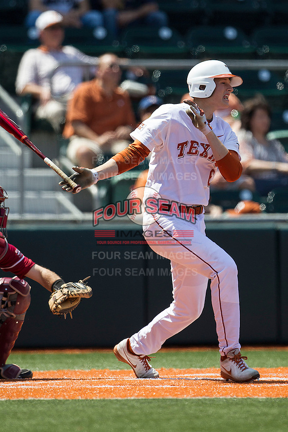 Texas Longhorns third baseman Erich Weiss #6 follows through on his swing against the Oklahoma Sooners in the NCAA baseball game on April 6, 2013 at UFCU DischFalk Field in Austin, Texas. The Longhorns defeated the rival Sooners 1-0. (Andrew Woolley/Four Seam Images).