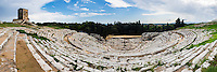 Syracuse, Sicily, panoramic photo of Teatro Greco (Greek Theatre), a Greek Amphitheatre, UNESCO World Heritage Site, Sicily, Italy, Europe. This is a panoramic photo of Teatro Greco (Greek Theatre), the Greek Amphitheatre at Syracuse, UNESCO World Heritage Site, Sicily, Italy, Europe.