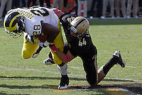 Purdue safety Landon Fiechter makes a tackle on Michigan runningback Fitzgerald Toussaint. The Michigan Wolverines defeated the Purdue Boilermakers 44-13 on October 6, 2012 at Ross-Ade Stadium in West Lafayette, Indiana.