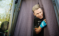 Christian Knees (DEU/SKY) peeping out of the bus before the start of the race<br /> <br /> Amstel Gold Race 2014