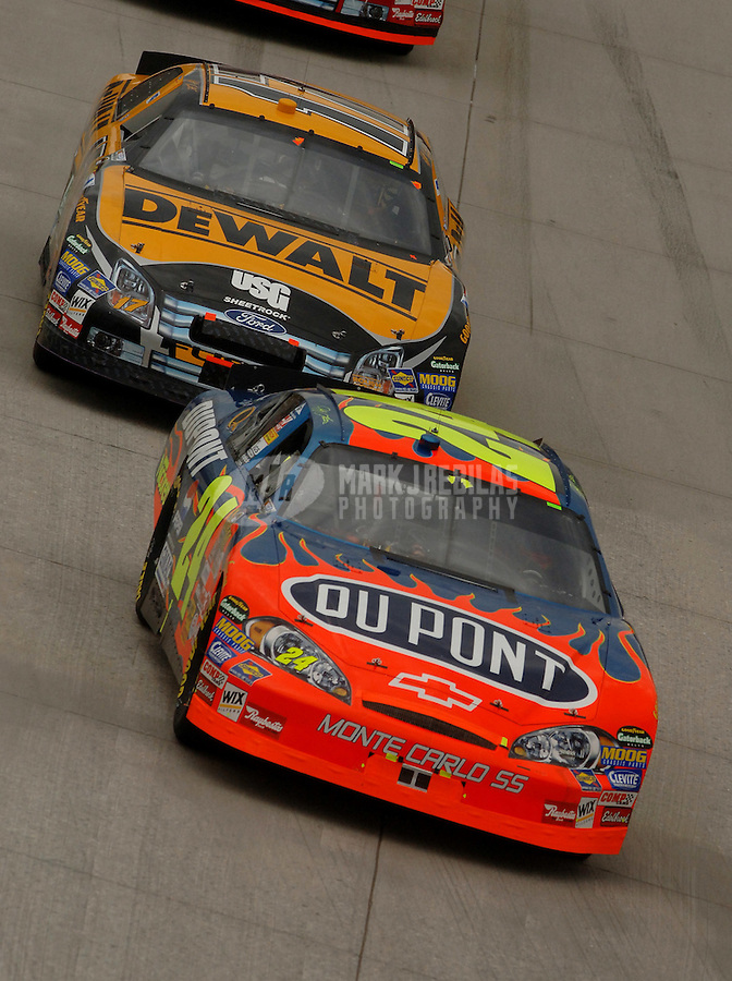 Sept. 24, 2006; Dover, DE, USA; Nascar Nextel Cup driver Jeff Gordon (24) leads Matt Kenseth (17) during the Dover 400 at Dover International Speedway. Mandatory Credit: Mark J. Rebilas