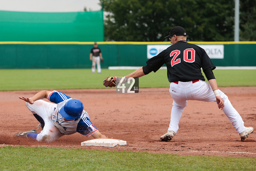27 july 2010: Kenji Hagiwara of France slides safely into third base as Dennis De Quint fails to tag him during France 8-2 victory over Belgium, in day 5 of the 2010 European Championship Seniors, in Stuttgart, Germany.