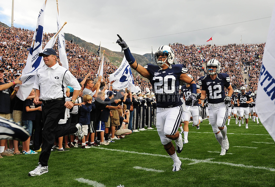 Sept. 19, 2009; Provo, UT, USA; BYU Cougars head coach Bronco Mendenhall (left) leads defensive back (20) Lee Aguirre and wide receiver (12) Stephen Covey onto the field prior to the game against the Florida State Seminoles at LaVell Edwards Stadium. Florida State defeated BYU 54-28. Mandatory Credit: Mark J. Rebilas-