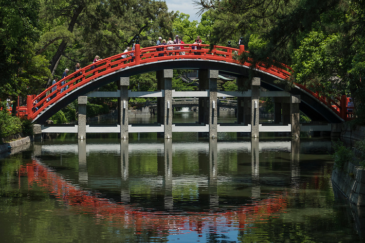 Leading to the entrance of the main shrine grounds is the beautiful Sorihashi Bridge, which creates a uniquely high arch over a pond.