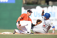 Angel Rosa (3) of the Inland Empire 66ers waits for the throw as Tyler Marincov (18) of the Stockton Ports slides into second base during a game at The Hanger on April 11, 2015 in Lancaster, California. San Jose defeated Lancaster, 8-3. (Larry Goren/Four Seam Images)
