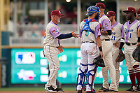 Frisco RoughRiders manager Joe Mikulik (25) makes a pitching change during a Texas League game against the Amarillo Sod Poodles on July 13, 2019 at Dr Pepper Ballpark in Frisco, Texas.  (Mike Augustin/Four Seam Images)