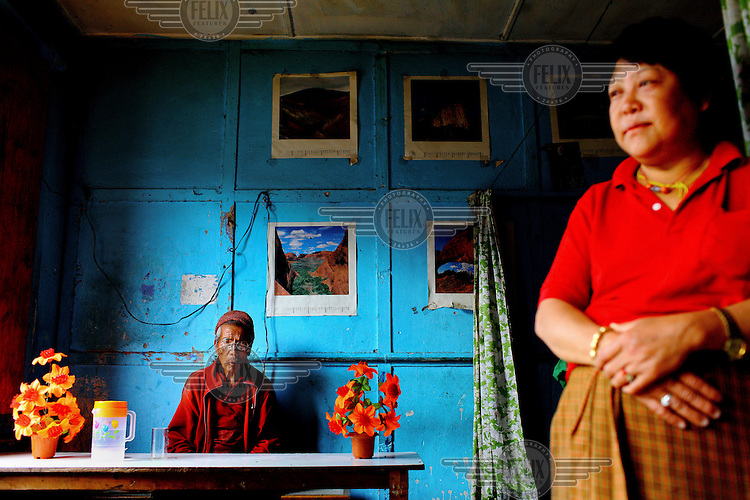 A man and a woman at a local restaurant in Thimpu.