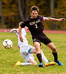 THOMASTON,  CT-101619JS04- Thomaston's Chet Pierce (3) clears the ball before a Terryville defender tries a sliding tackle during their Berkshire League match up Wednesday at Nystrom Park in Thomaston.<br /> Jim Shannon Republican-American