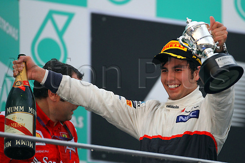 25.03.2012. Kuala Lumpur, Malaysia.  Mexican Formula One driver Sergio Perez of Sauber celebrates on the podium after winning the second place the Formula One Grand Prix of Malaysia at the Sepang circuit, outside Kuala Lumpur, Malaysia, 25 March 2012.