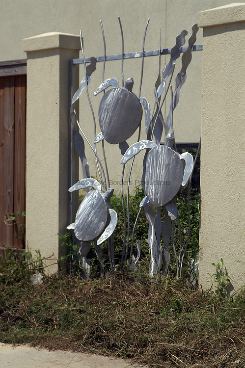 Sculptured sea turrtles incorporated into a fence is eye catching.