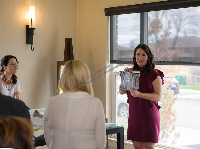 Designer Olivia Osborne shows a wall paper sample during Reno Magazine's Home Decor Workshop at Aspen Leaf Interiors Studio in Reno on Saturday, March 24, 2018.