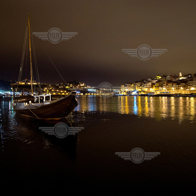 A view of The Quay Cais de Ribeira, with traditional boats (Barcos Rabelos) used for transporting port on the Douro River.