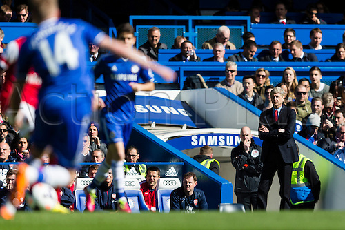 22.03.2014  London, England.  Arsenal Manager Arsene WENGER looks on during the Premier League game between Chelsea and Arsenal from Stamford Bridge.