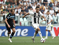 Calcio, Serie A: Juventus - Lazio, Torino, Allianz Stadium, 25 agosto, 2018.<br /> Juventus' Cristiano Ronaldo (r) in action with Lazio's Lucas Leiva (l) during the Italian Serie A football match between Juventus and Lazio at Torino's Allianz stadium, August 25, 2018.<br /> UPDATE IMAGES PRESS/Isabella Bonotto
