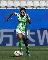 GRENOBLE, FRANCE - JUNE 12: Onome Ebi #5 of the Nigerian National Team dribbles during a game between Korea Republic and Nigeria at Stade des Alpes on June 12, 2019 in Grenoble, France.