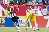 Kansas City Wizards goalkeeper Jimmy Nielsen picks up the ball from advancing Chivas USA forward Justin Braun. The Kansas City Wizards defeated CD Chivas USA 2-0 at Home Depot Center stadium in Carson, California on Sunday September 19, 2010.