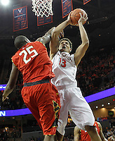 Virginia forward Anthony Gill (13) is fouled by Maryland forward Jonathan Graham (25) during the game Monday night in Charlottesville, VA. Photo/The Daily Progress/Andrew Shurtleff