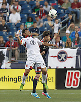 D.C. United forward Carlos Ruiz (20) and New England Revolution defender Stephen McCarthy (15) battle for the ball. In a Major League Soccer (MLS) match, the New England Revolution (blue) tied D.C. United (white), 0-0, at Gillette Stadium on June 8, 2013.