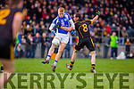 Teddy Doyle Templenoe run is halted by Noel Meaney Coolmeen during the Munster Junior football final in Mallow on Sunday