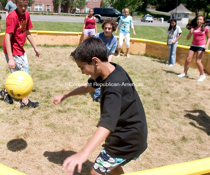 WATERBURY, CT- 02 JULY 2007- 070207JT02-<br /> Evan Cook, 11, of Roslyn, NY, plays a game called &quot;gaga&quot; with fellow campers Monday at Post University campus in Waterbury. The children are participants of Campus Kids, a Monday through Friday sleep-away camp for boys and girls ages 7 to 15.<br /> Josalee Thrift Republican-American